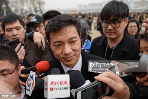 Baidu CEO Robin Li attends the opening session of the Chinese People's Political Consultative Conference at the Great Hall of the People on March 3...