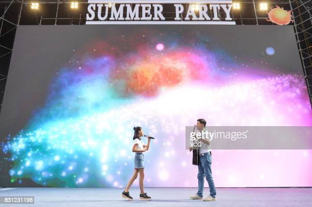 Baidu CEO Robin Li plays guitar and his daughter Brenda sings at Baidu's 2017 Summer Party on August 13 2017 in Beijing China