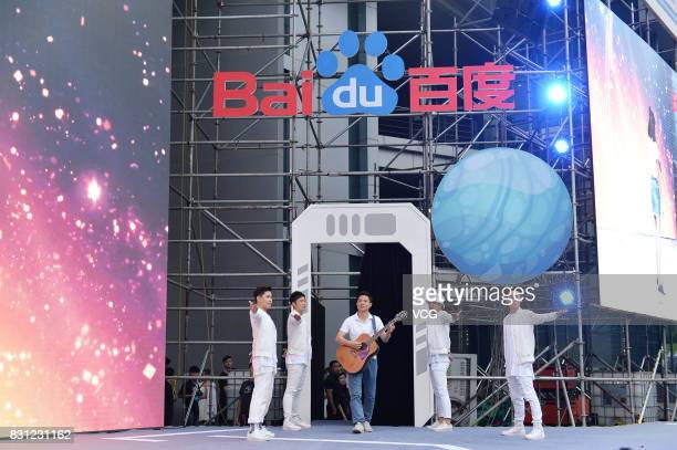 Baidu CEO Robin Li plays guitar at Baidu's 2017 Summer Party on August 13 2017 in Beijing China