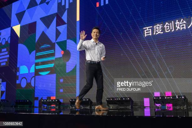 Baidu co-founder and CEO Robin Li arrives on stage at the annual Baidu World Technology Conference in Beijing on November 1, 2018.