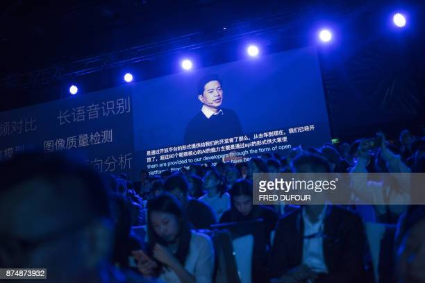 Baidu cofounder and chief executive Robin Li appears on a large screen during his speech at the annual Baidu World Technology Conference in Beijing...