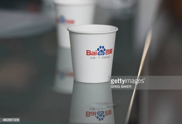 Baidu paper cup is seen on a table at the Baidu headquarters building in Beijing on December 17, 2014. Chinese search engine Baidu, the country's...