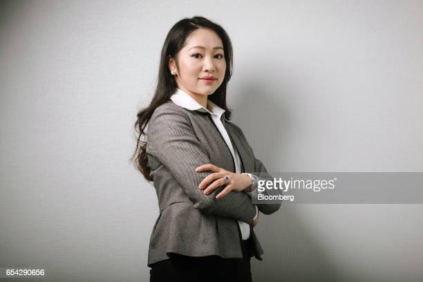 Baijing Yu portfolio manager and analyst for Comgest Far East Ltd poses for a photograph at the company's office in Hong Kong China on Tuesday Feb 28...