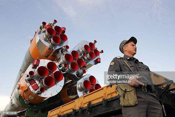 Russian police officer guards the Soyuz TMA9 rocket during a transportation to the launch pad at the Baikonur cosmodrome in Kazakhstan 16 September...