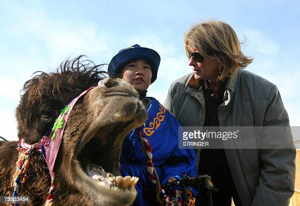 US celebrity Martha Stewart talks with a boy dressed in traditional Kazakh costume at Baikonur Cosmodrome 07 April 2007 US homemaking queen Martha...