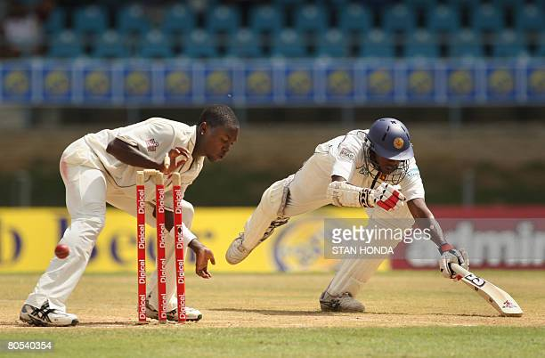 A bail is knocked off the stumps as Sri Lankan batsman Thilan Mirando is caught out just short of the crease while West Indies bowler Fidel Edwards...