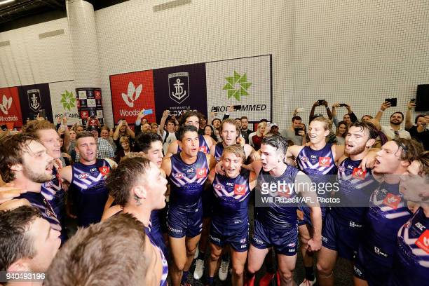 Bailey Banfield and Mitchell Crowden of the Dockers sing the team song after the teams win during the round two AFL match between the Fremantle...