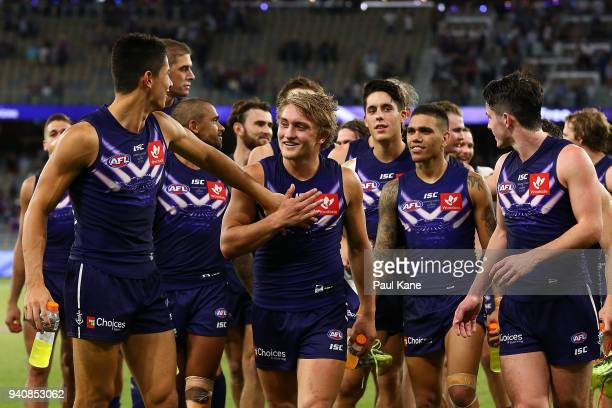 Bailey Banfield Mitchell Crowden and Andrew Brayshaw of the Dockers lead the team from the field during the round two AFL match between the Fremantle...