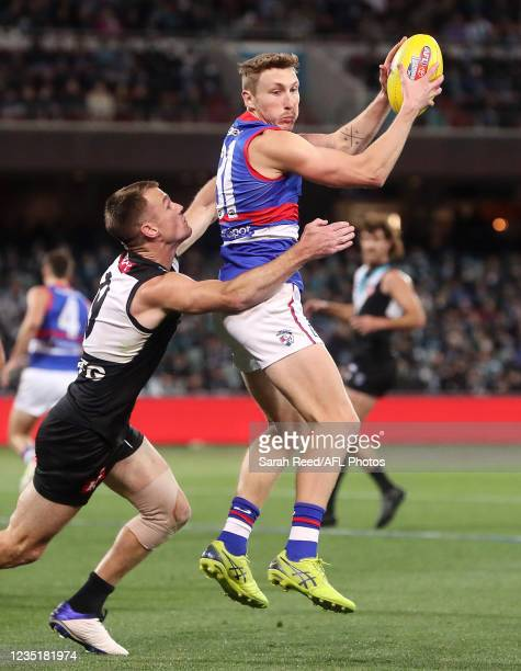 Bailey Dale of the Bulldogs marks the ball in front of Robbie Gray during the 2021 AFL Second Preliminary Final match between the Port Adelaide Power...