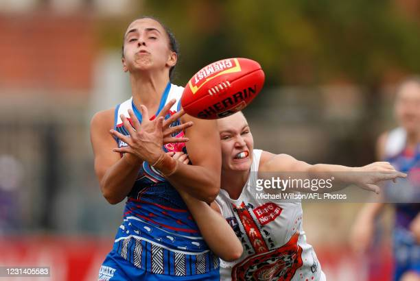 Bailey Hunt of the Bulldogs and Alyce Parker of the Giants in action during the 2021 AFLW Round 05 match between the Western Bulldogs and the GWS...
