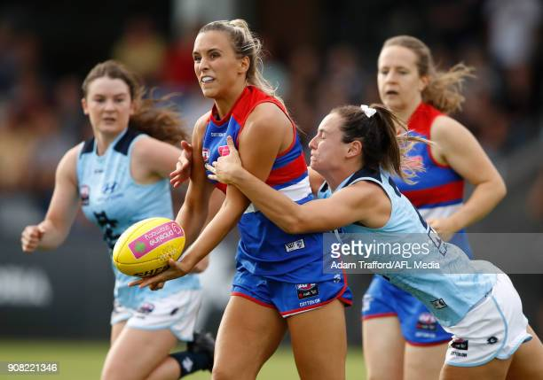 Bailey Hunt of the Bulldogs is tackled by Nicola Stevens of the Blues during the 2018 AFLW Practice match between the Western Bulldogs and the...