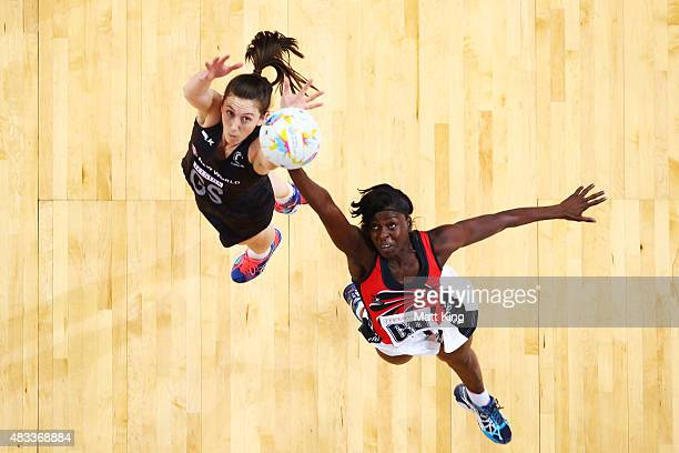 Bailey Mes of New Zealand competes with Kemba Duncan of Trinidad Tobago during the 2015 Netball World Cup match between New Zealand and Trinidad...