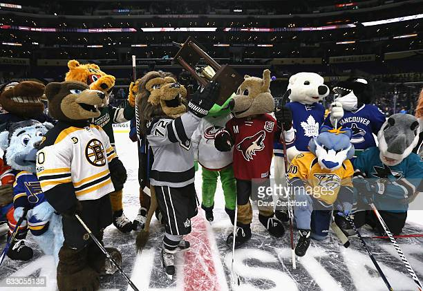 Bailey of the Los Angeles Kings holds up the trophy after the mascot showdown prior to the 2017 Honda NHL AllStar Game at Staples Center on January...