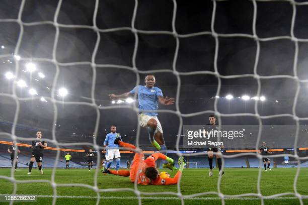 Bailey PeacockFarrell of Burnley makes a save from Gabriel Jesus of Manchester City during the Premier League match between Manchester City and...