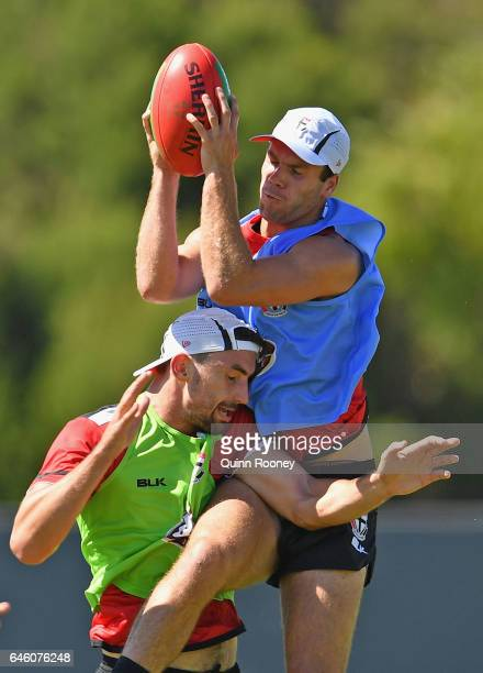 Bailey Rice of the Saints marks over the top of Billy Longer during a St Kilda Saints AFL training session at Linen House Oval on February 28 2017 in...