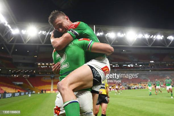 Bailey Simonsson of the Raiders celebrates scoring a try with Jack Wighton of the Raiders during the round 23 NRL match between the Canberra Raiders...