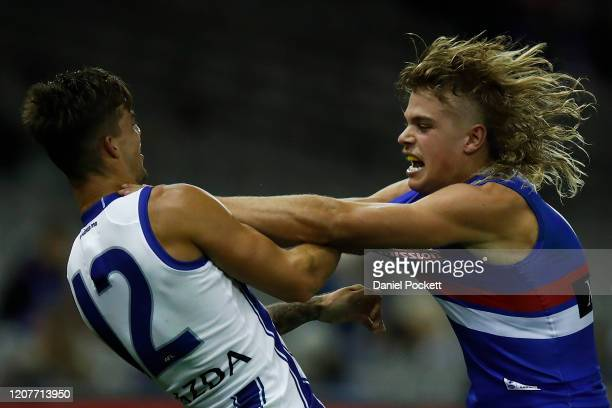 Bailey Smith of the Bulldogs and Jy Simpkin of the Kangaroos wrestle during the 2020 Marsh Community AFL Series match between the Western Bulldogs...