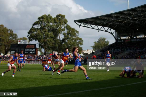 Bailey Smith of the Bulldogs kicks the ball during the round four AFL match between the Western Bulldogs and the Brisbane Lions at Mars Stadium on...