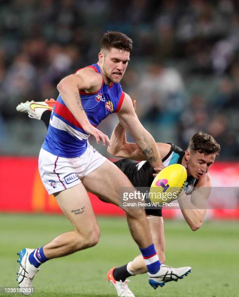 Bailey Williams of the Bulldogs and Orazio Fantasia of the Power during the 2021 AFL Second Preliminary Final match between the Port Adelaide Power...