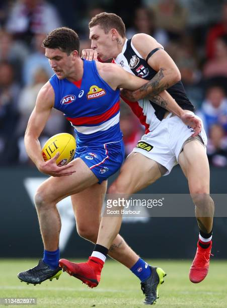 Bailey Williams of the Bulldogs is tackled by Matthew Parker of the Saints during the 2019 JLT Community Series AFL match between the Western...