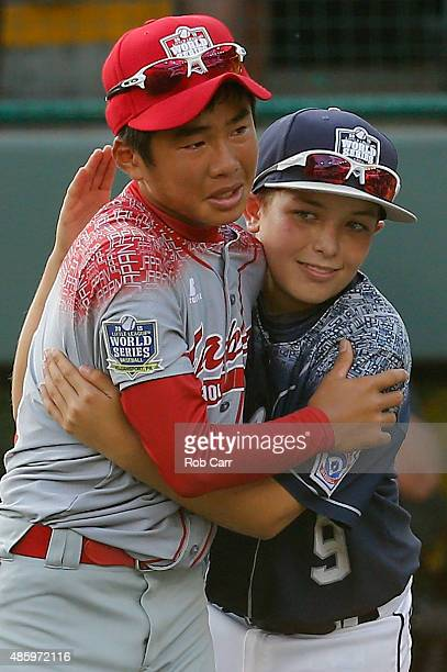 Bailey Wirt of the MidAtlantic team from Red Land Little League of Lewisberry Pennsylvania congratulates Yugo Aoki of team Japan after Japan defeated...