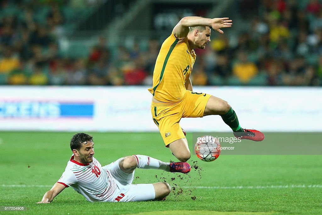Bailey Wright of Australia is tackled during the 2018 FIFA World Cup Qualification match between the Australia Socceroos and Tajikistan at the Adelaide Oval on March 24, 2016 in Adelaide, Australia.