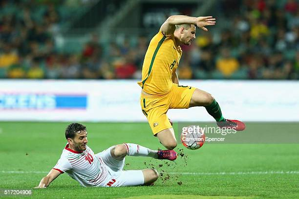 Bailey Wright of Australia is tackled during the 2018 FIFA World Cup Qualification match between the Australia Socceroos and Tajikistan at the...