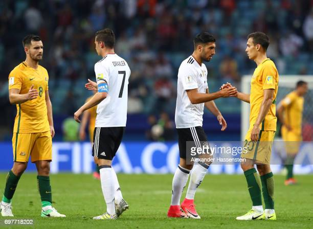 Bailey Wright of Australia Julian Draxler of Germany Emre Can of Germany and Trent Sainsbury of Australia shake hands after the FIFA Confederations...