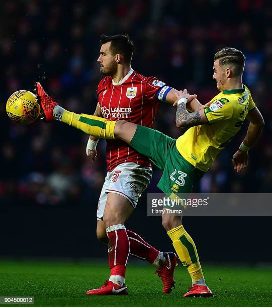 Bailey Wright of Bristol City is tackled by James Maddison of Norwich City during the Sky Bet Championship match between Bristol City and Norwich...