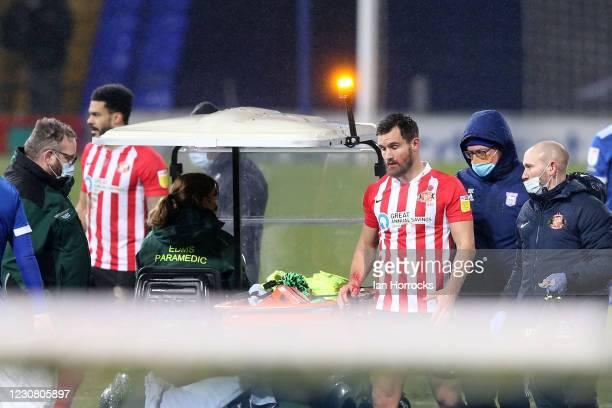 Bailey Wright of Sunderland is taken off injured during the Sky Bet League One match between Ipswich Town and Sunderland at Portman Road on January...