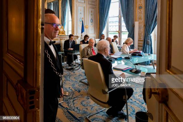 A bailiff closes the door as members of the French Constitutional Council Lionel Jospin Michel Charasse President Laurent Fabius and Nicole...
