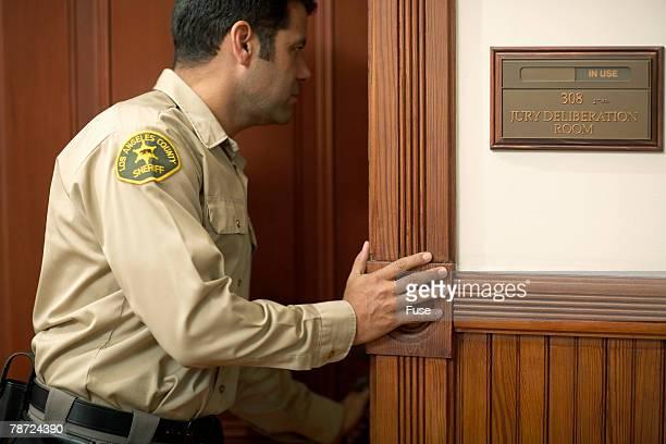 Bailiff Looking into Jury Room