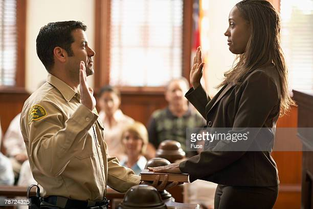 bailiff swears in witness - juror law stock pictures, royalty-free photos & images