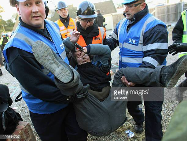 Bailiffs detain a protester during the eviction of Dale Farm travellers camp on October 19 2011 near Basildon England Travellers have fought for 10...