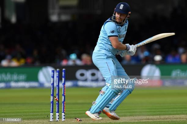 Bails fly as England's Jonny Bairstow loses his wicket for 36 runs during the 2019 Cricket World Cup final between England and New Zealand at Lord's...