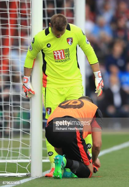 Baily Cargill of AFC Bournemouth ties up Artur Boruc of AFC Bournemouth boots during the Premier League match between AFC Bournemouth and Stoke City...