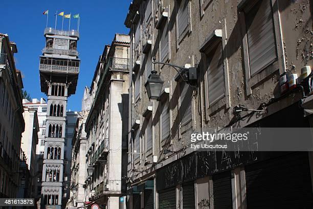 Baixa district Elevador de Santa Justa at end of street flanked by buildings