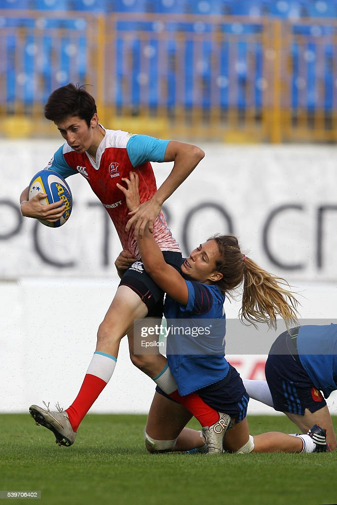 Baizat Khamidova (L) of Russia and Marjorie Mayans of France vie for the ball during the Rugby 7's Grand Prix Series - Women final match between Russia and France at Tsentralny stadium on June 12, 2016 in Kazan, Russia.