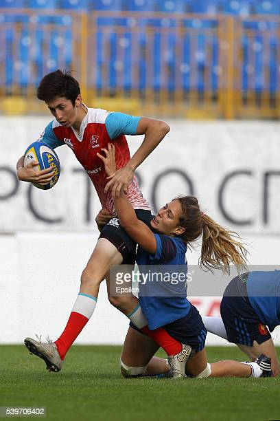 Baizat Khamidova of Russia and Marjorie Mayans of France vie for the ball during the Rugby 7's Grand Prix Series Women final match between Russia and...