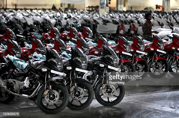 Bajaj Auto Ltd Pulsar motorcycles sit ready at the end of the assembly line at the company's factory in Pune India on Monday July 5 2010 Bajaj Auto...