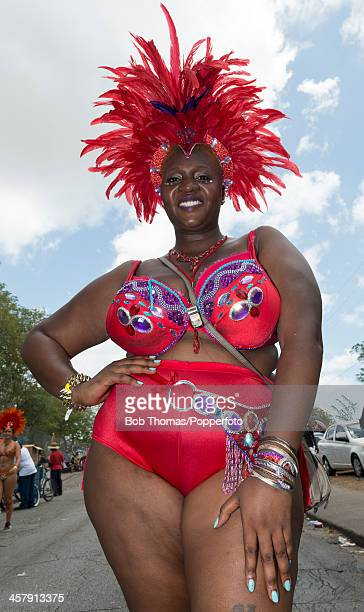 Bajan woman wearing a colourful costume enjoying the Crop Over festival in Bridgetown Barbados 5th August 2013