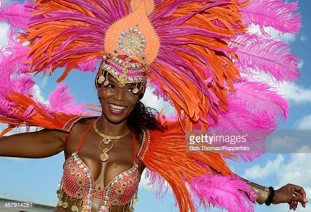 Bajan woman wearing a colourful costume whilst enjoying the Crop Over festival in Bridgetown Barbados 5th August 2013