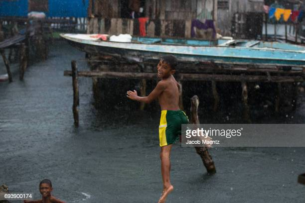 bajau boy jumping into the ocean. - bajau stock pictures, royalty-free photos & images