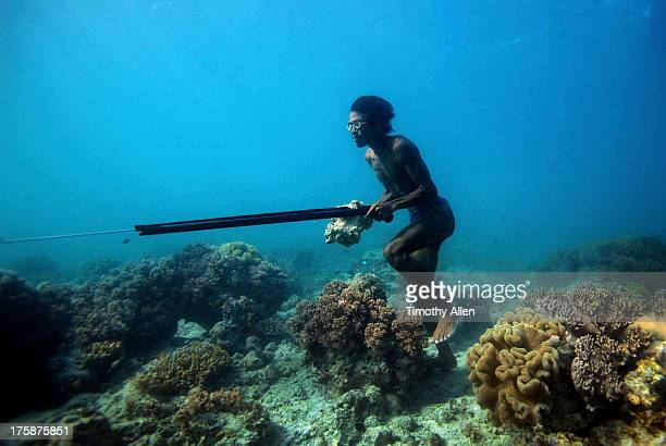 Bajau breath diver hunting on seabed