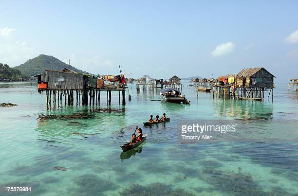 bajau floating village on reef in the celebes sea - bajau stock pictures, royalty-free photos & images