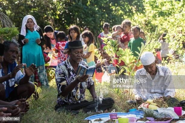 Bajau Imam reads from the Koran during a water festival held annually by the inhabitants of kalapuan Island. The festival is a purification ritual...
