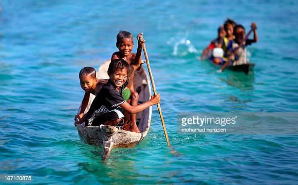 Bajau kids on their canoe, taken during phototrip at bodgaya island, sempoerna
