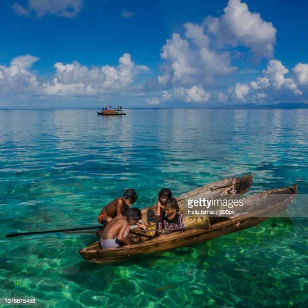 Bajau Kids on their Sampan