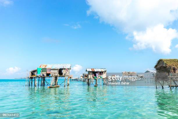 sabah, malaysia - august 17, 2015 : bajau laut house in bodgaya island, sabah, malaysia. they lived - bajau stock pictures, royalty-free photos & images