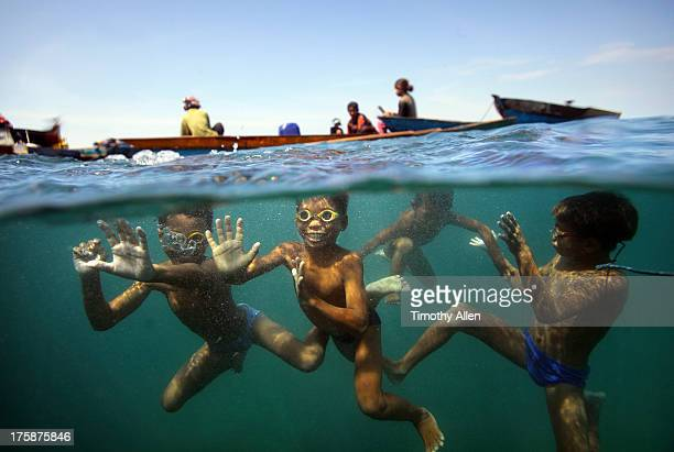 Bajau sea gypsy children playing underwater